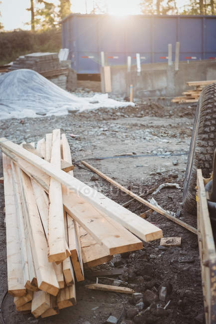 Wooden planks and heap of mud at construction site — Stock Photo