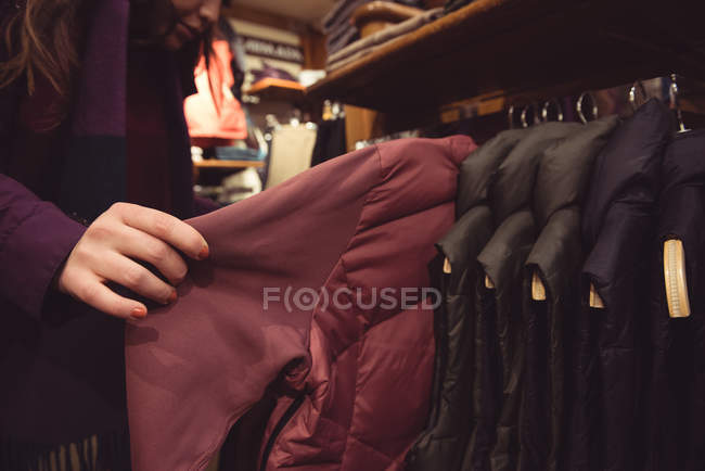 Close-up of woman selecting apparel in a clothes shop — Stock Photo