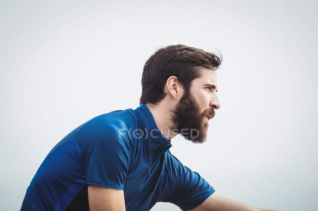 Close up of a handsome athlete stretching — Stock Photo