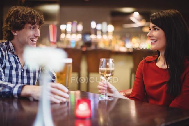 Happy couple having drinks in bar — Stock Photo