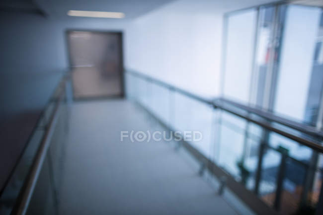 Empty corridor of a hospital interior, blurred — Stock Photo