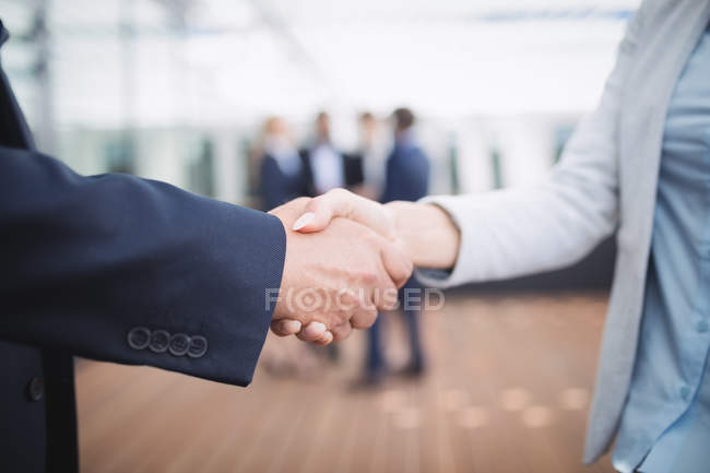 Close-up of business people shaking hands — Stock Photo