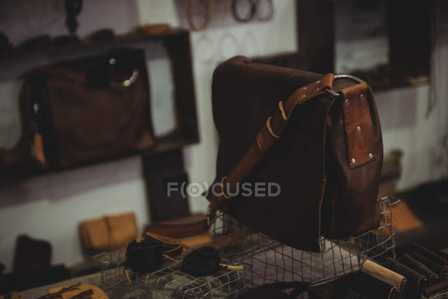 Various leather accessories on table in workshop — Stock Photo