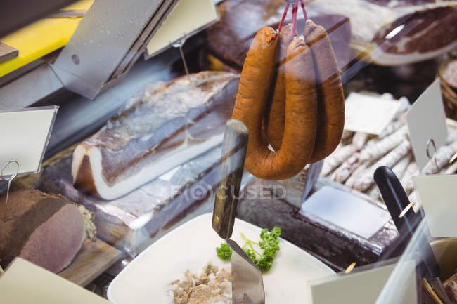 Various types of sausage and salami in supermarket — Stock Photo