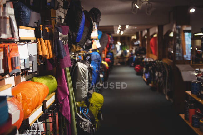 Variety of bags on racks in store interior — Stock Photo