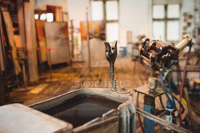 Empty workstation at glassblowing factory — Stock Photo