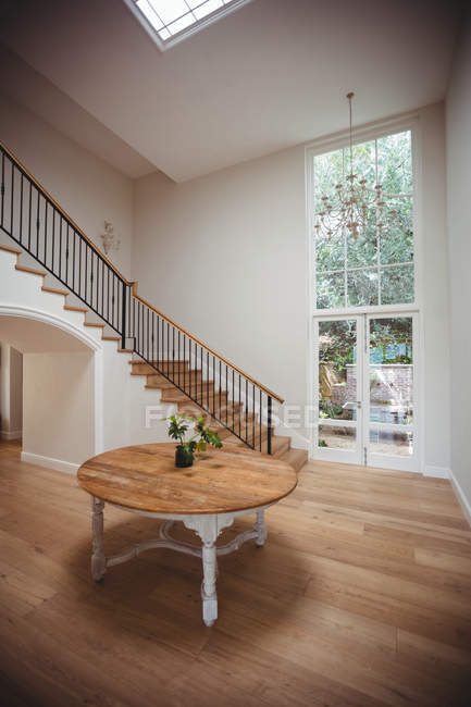 Interior of home with wooden floor and staircase with white walls — Stock Photo