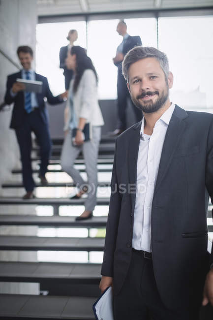 Portrait of a confident businessman in office — Stock Photo