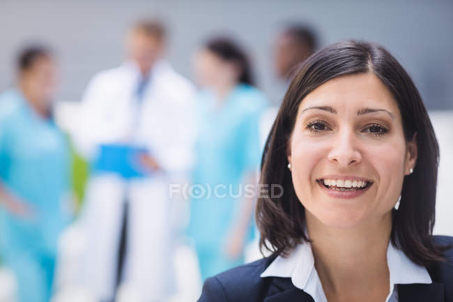 Portrait of smiling female doctor in hospital premises — Stock Photo