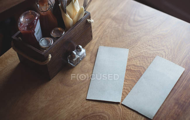 Blank envelopes on cafe table with sauce tray at cafe — Stock Photo