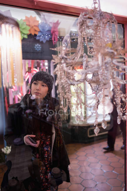 Woman looking at chandeliers in the supermarket — Stock Photo