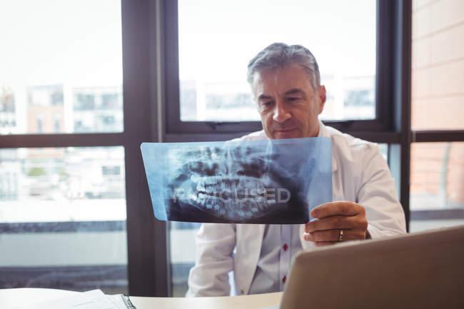 Doctor examining x-ray at hospital — Stock Photo