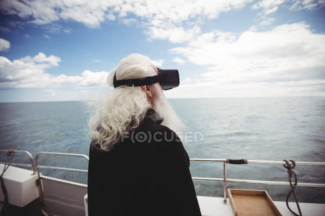 Back view of Fisherman using virtual reality headset on fishing boat — Stock Photo