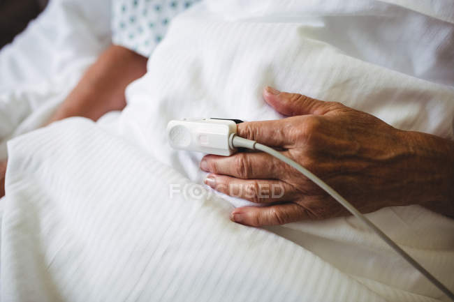 Pulse oximeter on a patient hand in hospital — medical