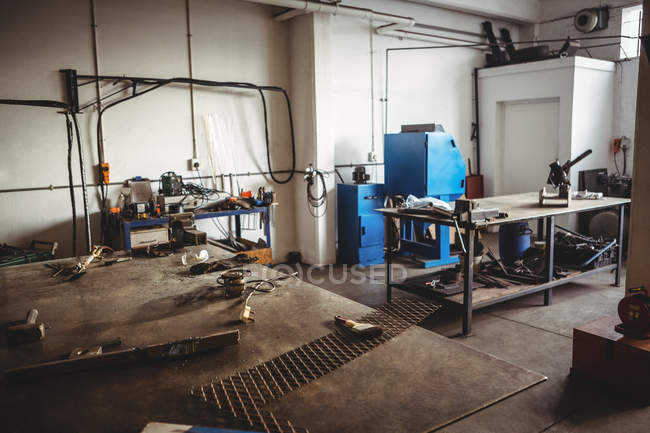 Interior of empty workshop with tables and tools — Stock Photo