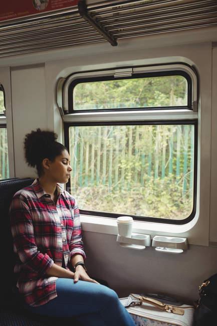 Woman sleeping while sitting in train — Stock Photo
