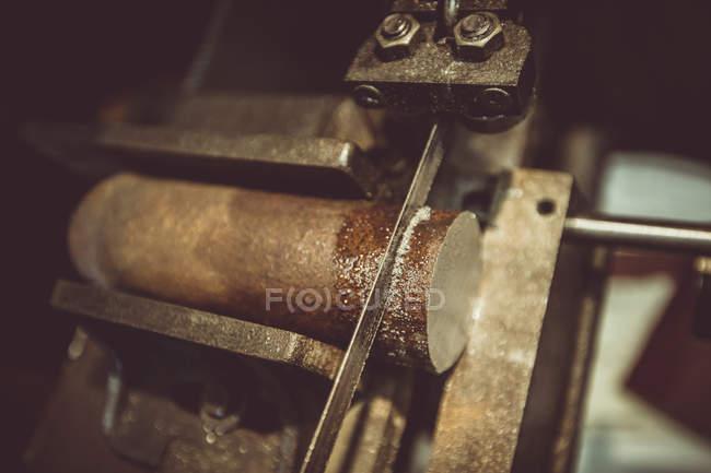 Close-up of machine cutting wood — Stock Photo