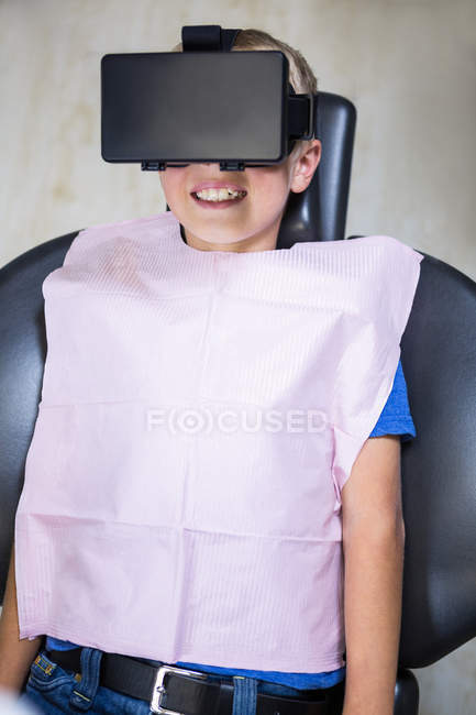 Boy using virtual reality headset during a dental visit in clinic — Stock Photo