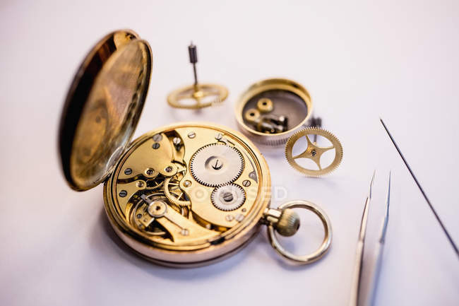 Old pocket watch machine with gears — Stock Photo