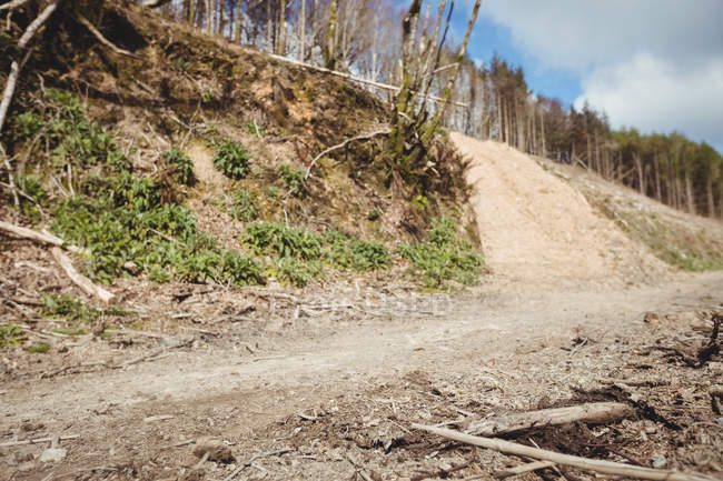Empty dirt road on mountain against sky — Stock Photo