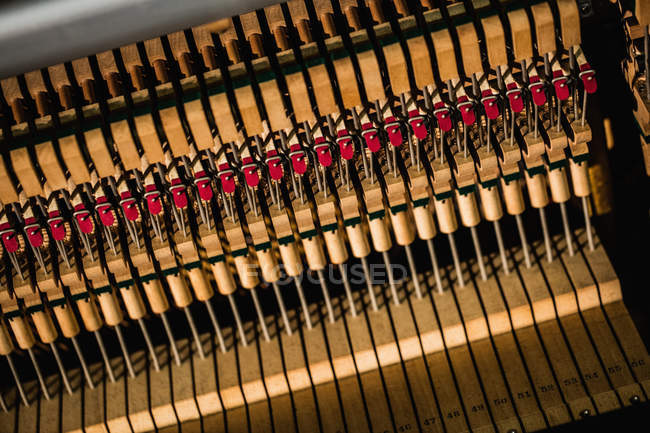 Close-up of piano strings in workshop, full frame — Stock Photo