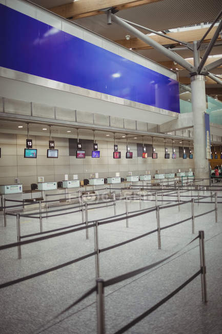 Empty check-in counters in airport terminal — Stock Photo