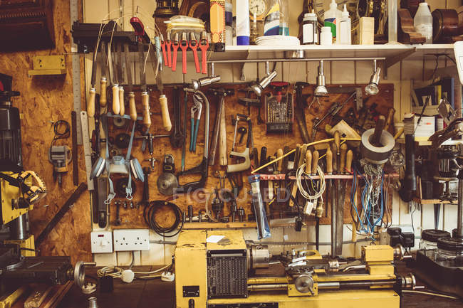 Old horologists workshop with clock repairing tools, equipment and machinery — Stock Photo