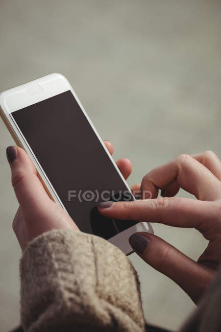 Cropped image of woman using mobile phone — Stock Photo