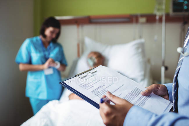 Hands of male doctor preparing medical report in hospital — Stock Photo