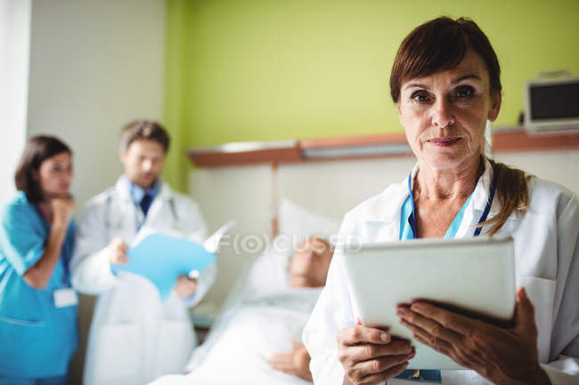 Female doctor using digital tablet in hospital — Stock Photo