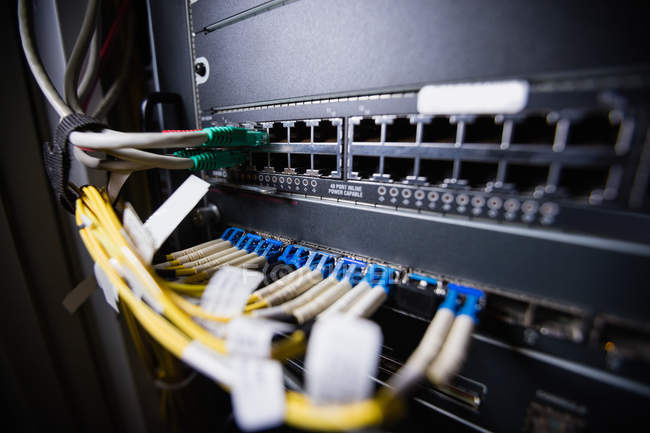 Close-up of rack mounted server in server room — Stock Photo