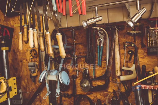Old horologists workshop with clock repairing tools, equipment hanging on the wall — Stock Photo