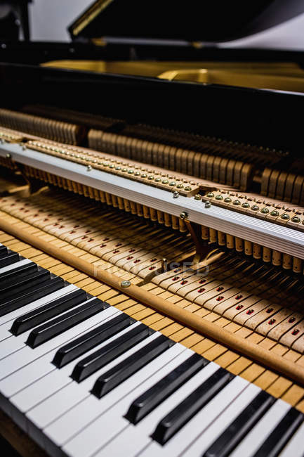 Close-up of old piano keyboard at workshop — Stock Photo