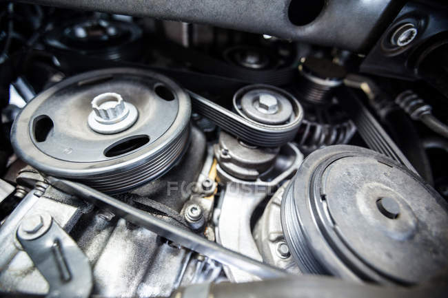 Close-up of car engine and components at repair garage — Stock Photo