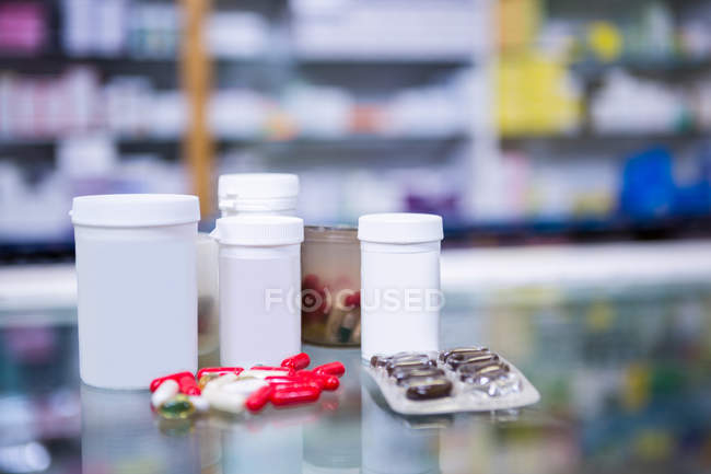 Close-up of various prescription medicines on table in pharmacy — Stock Photo