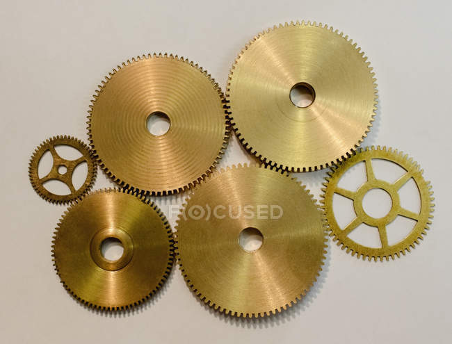Collection of various gears on white paper in workshop — Stock Photo