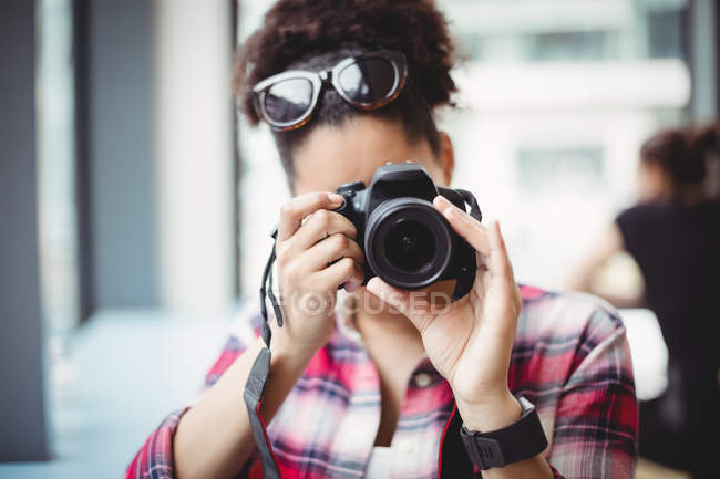Close-up of woman photographing at restaurant — Stock Photo