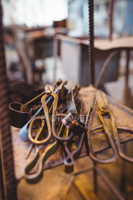 Close-up of various rusty glassblowing tools at glassblowing factory — Stock Photo