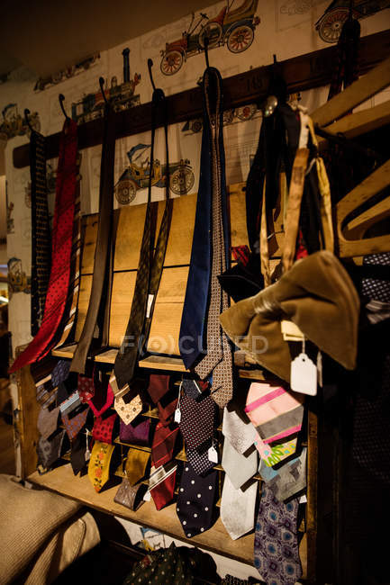 Various ties on display at boutique store — Stock Photo