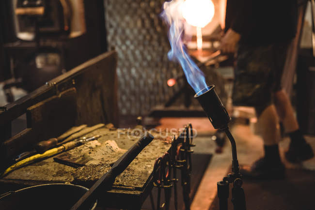 Close-up of marvers table with blow torch and glassblowing tools at glassblowing factory — Stock Photo