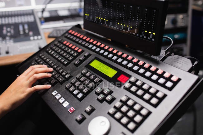 Hand of female student using sound mixer keyboard in a studio — Stock Photo