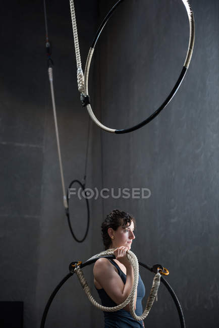 Gymnast holding gymnastics hoop in fitness studio — Stock Photo