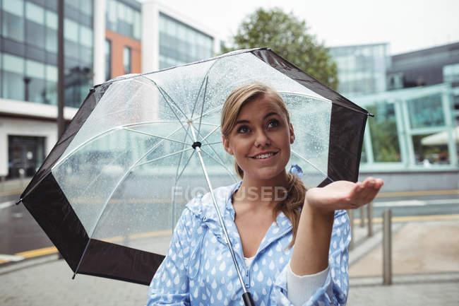 Beautiful woman enjoying rain during rainy season — Stock Photo