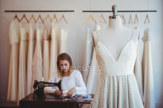 Couture hanging on mannequin in the studio — Stock Photo