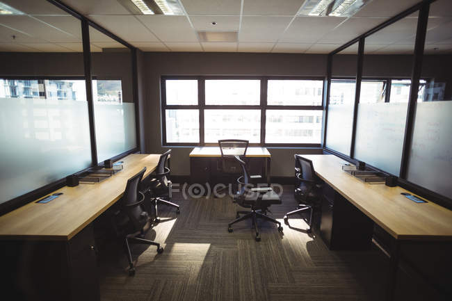 Table and empty chairs in  modern office — Stock Photo