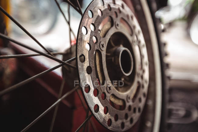 Close-up of motorcycle disc brake in workshop — Stock Photo