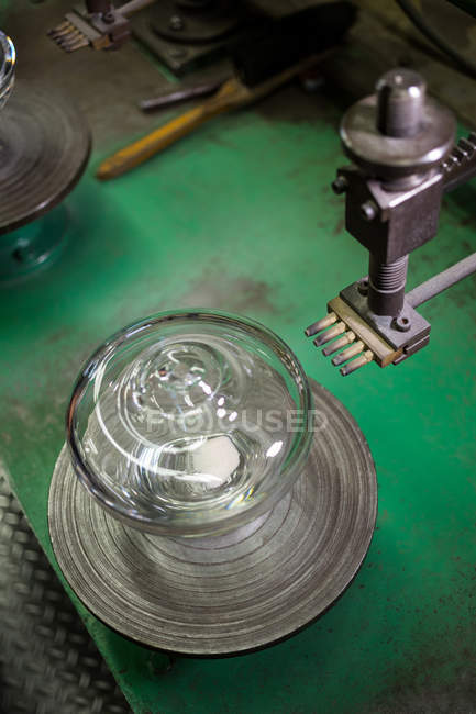 Close-up of glassware by machine at glassblowing factory — Stock Photo