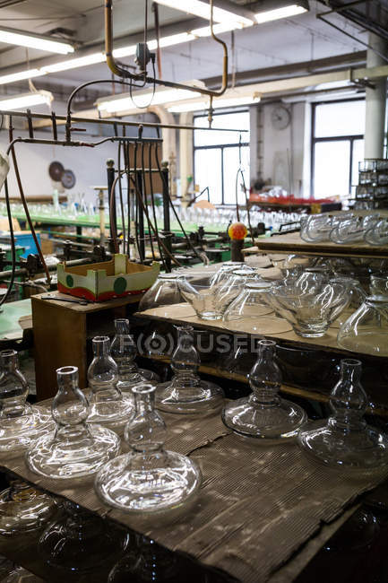 Empty glassware in workshop at glassblowing factory — Stock Photo