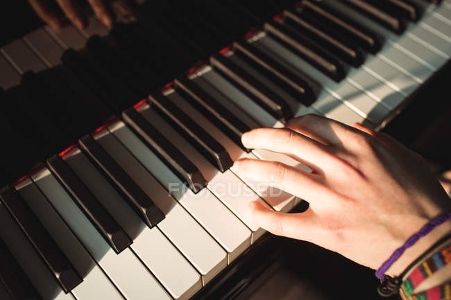 Close-up of Woman playing a piano in music studio — Stock Photo