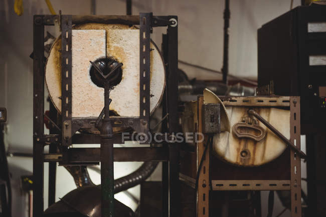 Storage tank and metal container at glassblowing factory — Stock Photo